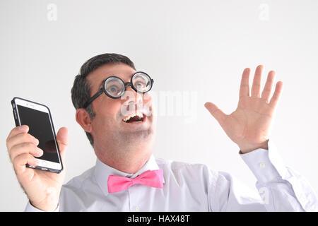 Geeky man holds a smart phone and has a communication idea.    Communication concept. Real people copy space - Stock Photo