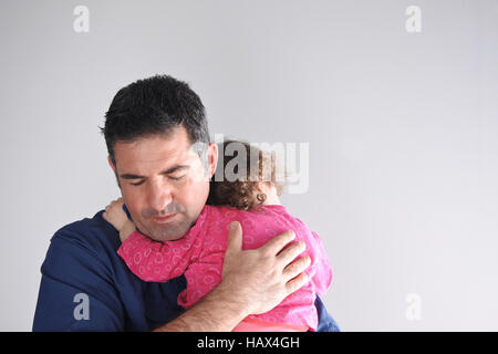 Father hugs his daughter. Parenting, fatherhood children and family concept. copy space - Stock Photo