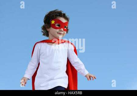 Little superhero child (girl age 2-3).  concept photo of Super hero, girl power, plays pretend, childhood, imagination. - Stock Photo