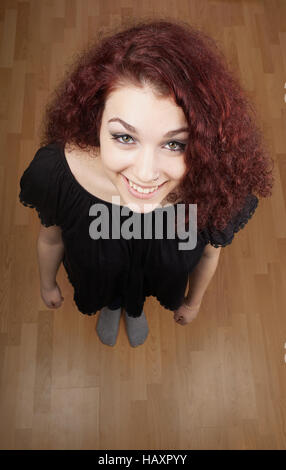 high angle view of beautiful young woman looking up - Stock Photo