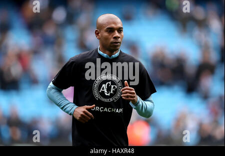 Manchester City's Fernandinho warms up in a t-shirt remembering the Brazil football team Chapecoense who were involved - Stock Photo