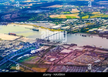 The Dartford Bridge Crossing over the river Thames looking North, Essex to South, Kent from an aeroplane landing - Stock Photo