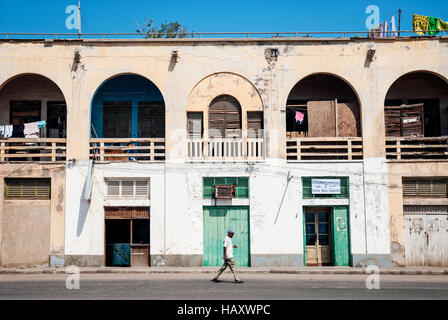 local red sea style architecture street in central massawa old town eritrea - Stock Photo