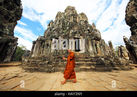 Buddhist monk in the ruins of the Bayon Khmer Temple, Angkor Thom , Siem Reap, Cambodia - Stock Photo