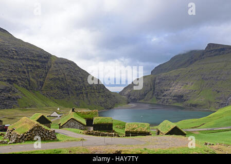 The pictoresque village of Saksun with the turf roofs, Faroe Islands, Denmark - Stock Photo