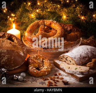 Baking for German Christmas: stollen, bretzel, bread. - Stock Photo