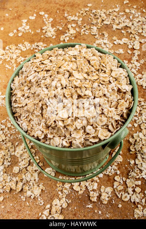 healthy scottish porridge in a green bucket - Stock Photo