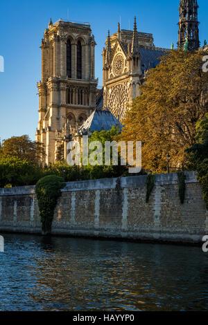 Notre Dame de Paris cathedral at sunset with the Seine River on Ile de La Cite. Autumn evening in Paris, France - Stock Photo