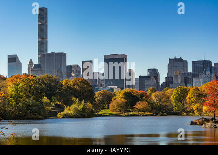 Fall in Central Park at The Lake with Midtown skyscrapers. Morning view with colorful Autumn foliage. Manhattan, - Stock Photo