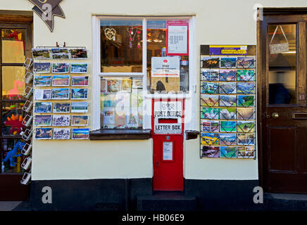 Postcards displayed outside the post office in the village of Dunster, Somerset, England UK - Stock Photo
