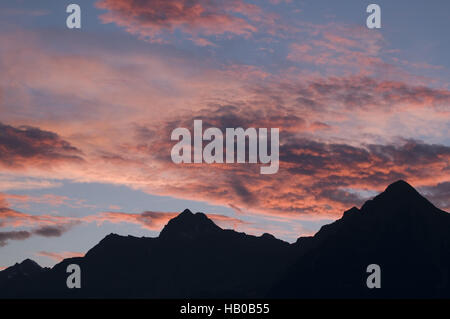 evening sky with mountain silhouette - Stock Photo