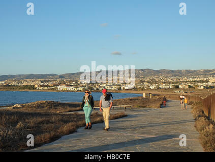 People walk along the Paphos coastal path in Kato Paphos, Paphos, Cyprus, - Stock Photo