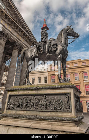 Statue of Duke of Wellington, riding a horse, wearing a traffic cone on his head. In front of Gallery of Modern - Stock Photo