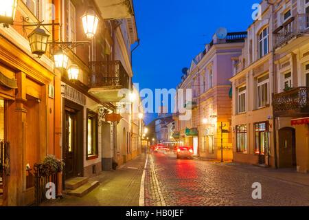 Pilies Street at night, Vilnius, Lithuania - Stock Photo