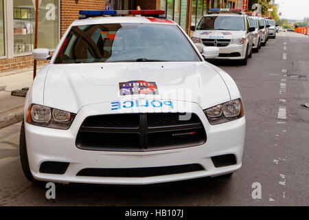 A police car parked on Ste-Catherine street in downtown Montreal - Stock Photo