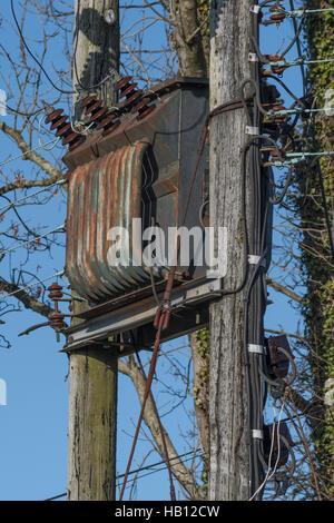 Rural power distribution electrical transformer. - Stock Photo