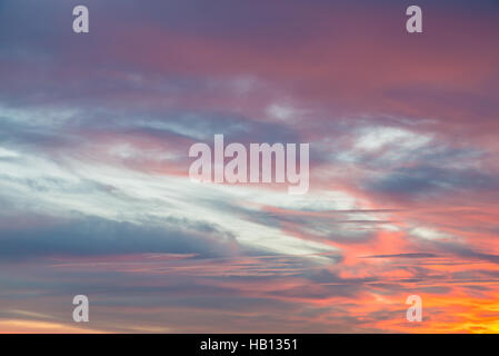 Sunset blue, orange, pink, magenta, yellow, fucsia sky and clouds background - Stock Photo