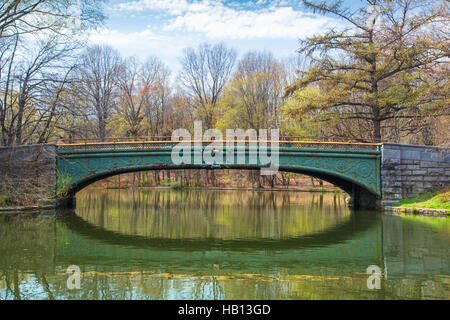 View of footbridge and lake at beautiful Prospect Park in Brooklyn, New York City - Stock Photo