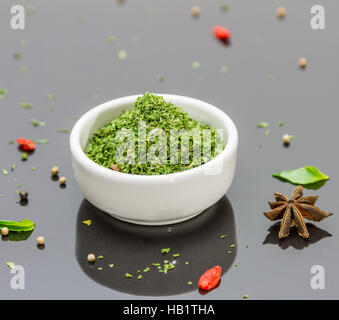 Green parsley in the backgroud. - Stock Photo