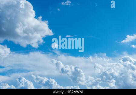 cumulus clouds against a blue sky - Stock Photo