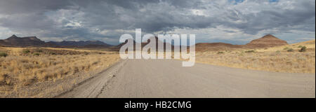 The D707, scenic dirt road in the desert through the Tiras mountains, Namibia - Stock Photo