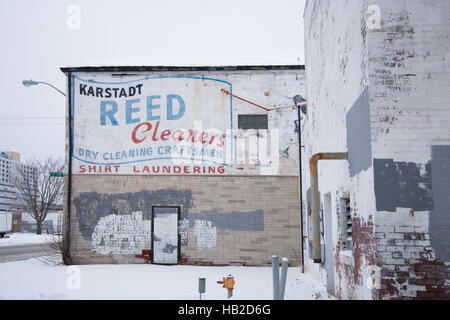 Painted advertising sign on the side of a building in Indianapolis, Indiana years ago. - Stock Photo