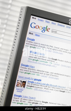 Google search engine page with search results displayed on a computer monitor - Stock Photo