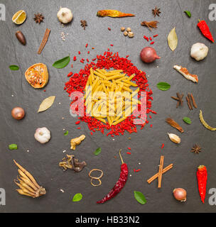 Pasta with spices on background for cooking. - Stock Photo
