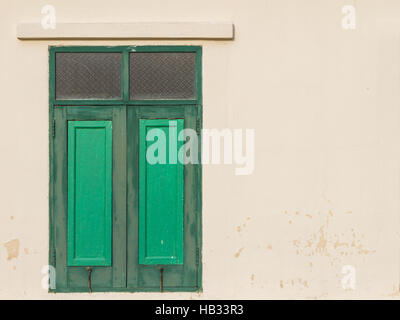 Green window of old wooden house background. - Stock Photo