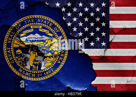flags of Nebraska and USA painted on cracked wall - Stock Photo