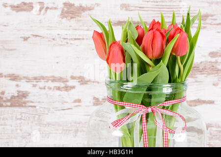 bunch of tulips in vase - Stock Photo
