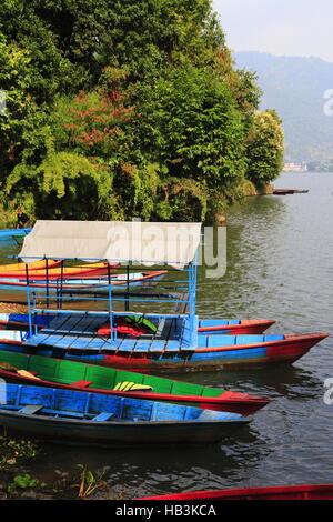 Rowboats at the Phewa lake - Stock Photo