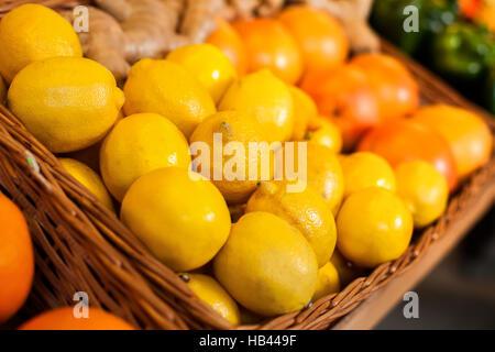 Fresh lemons in wicker boxes. - Stock Photo