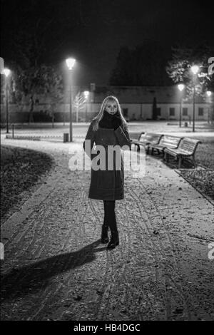 Woman in the park at night - Stock Photo