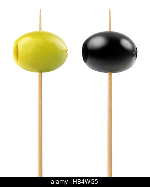 Isolated olives. Green and black pitted olive fruits on a wooden sticks isolated on white background with clipping - Stock Photo