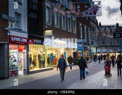 Christmas shopping in city centre, Hereford, England, UK - Stock Photo