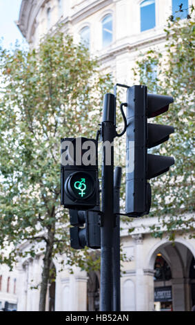Heterosexual pedestrian crossing light in central London - Stock Photo