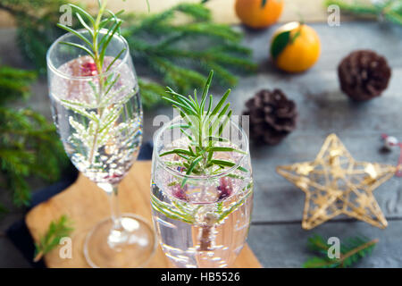 Mimosa festive drink for Christmas - champagne cocktail with rosemary for Christmas party - Stock Photo