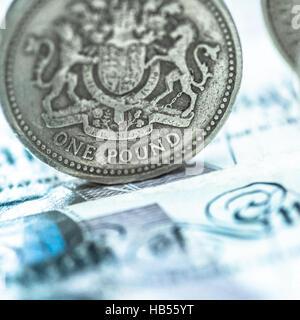 Pound coin on twenty pound note - Stock Photo