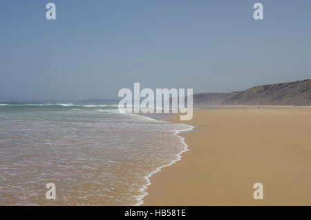 View of beautiful Bordeira beach, famous surfing place in Algarve region, Atlantic ocean, Portugal - Stock Photo