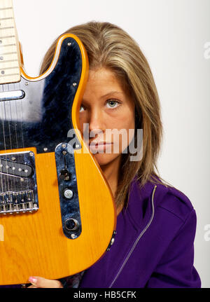 Beautiful young lady with guitar - Stock Photo