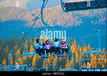 Women with children on a ski lift in Bukovel. Bukovel is the most popular ski resort in Ukraine. - Stock Photo