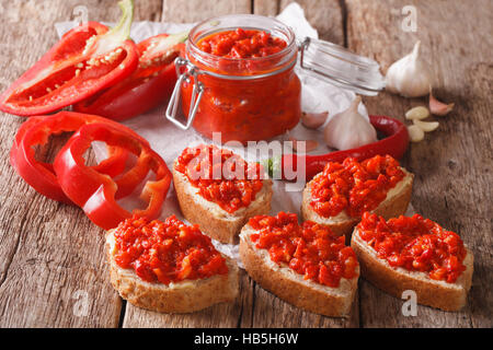 traditional Balkan ajvar from peppers with garlic close-up on the table. horizontal - Stock Photo