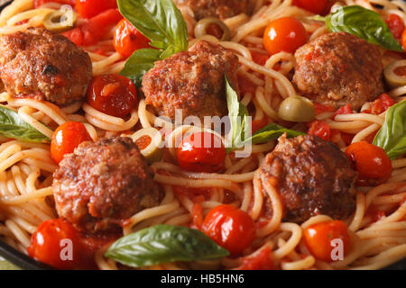 Food background: spaghetti with meatballs in tomato sauce macro. horizontal - Stock Photo