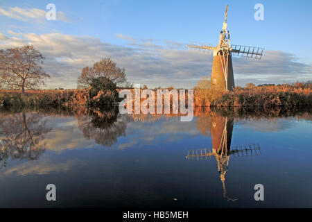 A view of the River Ant on the Norfolk Broads with Turf Fen Drainage Mill at Ludham, Norfolk, England, United Kingdom. - Stock Photo