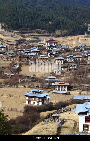 Colorful Dzong in beautiful bhutanese Village - Stock Photo