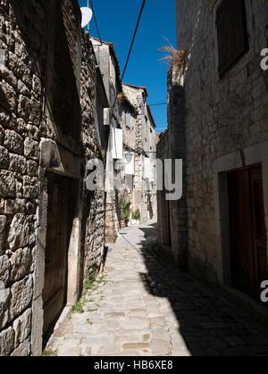 Narrow streets in the historic town of Trogir, Dalmatian Coast, Republic of Croatia. - Stock Photo