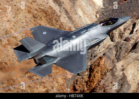 Lockheed Martin F-35A Lighting II from the 323 Squadron, Royal Netherlands Air Force, flies low level through the - Stock Photo