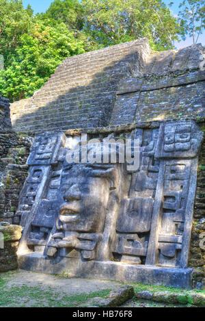 Stucco Mask, The Mask Temple, Lamanai Mayan Site, Belize - Stock Photo