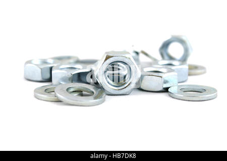 Several metal screw washers and nuts - Stock Photo